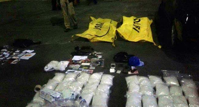 Mayat terbungkus kantong dan barang bukti yang diamankan BNN (ist)